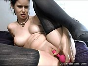 cute brunette masturbates with dildo on.