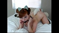 Redhead Girl puts a kitten tail in the ass and gag in mouth on cam