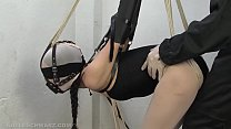 Encased in pantyhose in a armbinder, gagged and...