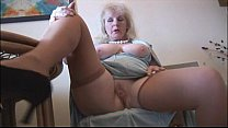 Curvy mature lady in stockings strips and poses Thumbnail