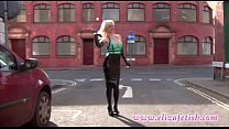 Hot latex clad blonde in high heels and William Wylde designer dress