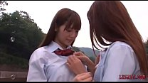 2 Schoolgirls Kissing Petting While Standing Ou...