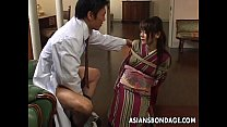 Asian lass is sucking on the dick tied up thumb