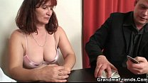 Oldie in stockings takes two rods thumb