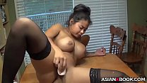 Horny asian toys her cunt