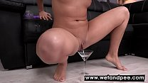 Hot brunette covers herself in piss and masturb...