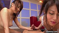 Two hot Asian bitches sucking on the bloke's pe...