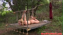 Bonded submissive whipped outdoors
