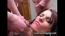 skank gets her face painted with cum