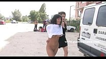 Sexy brunette with long hair in public piazza n...