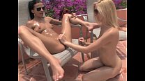 2 girls playing fisting on pool deck