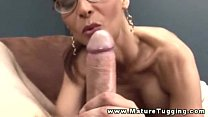 Busty mature in spex tugging on cock and cant get enough Thumbnail