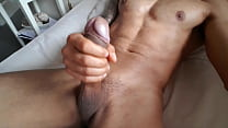 Mixed race guy playing with his dick