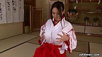 Brunette Asian in a red and white kimono rubs her cunt