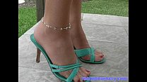 Daisy models her green heels ankle bracelet and...