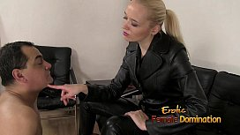 Dominatrix in black leather playing with a slave