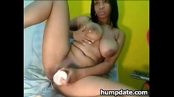 Busty black babe dildoing her horny pussy