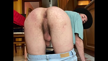 guy undresses in the kitchen after smoking