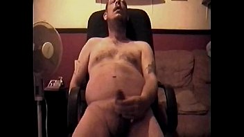 Bisexual amateur sits in his computer chair naked...