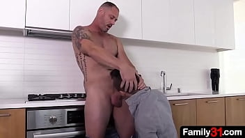 The pretty stepson is on his knees with a stepdad&#039_s big dick in his mouth