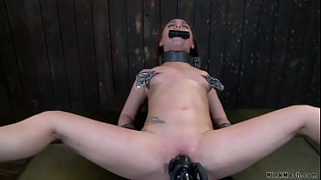 Chained brunette sub butt plugged
