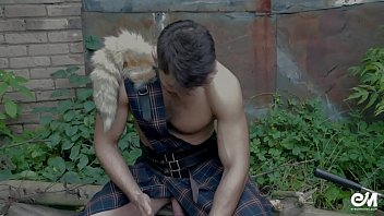 Cute shirtless guy in scottish kilt playing with...