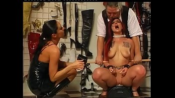 Pleasure and pain for a redhead girl in the hands of sadic people
