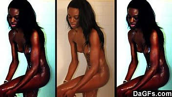 Skinny ebony caught while she takes a shower and masturbates for the camera