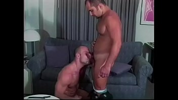 Hunk cop sits on the couch and takes large cock down his throat 22 min