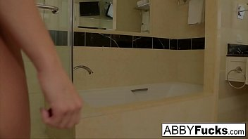 Abigail takes a quick shower and shaves her pussy