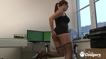 Busty milf at work