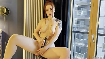Pretty redhead wife masturbates near the window. KleoModel homemade