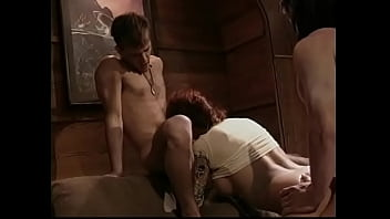 Two young fit studs get sucked and fucked by slutty redhead