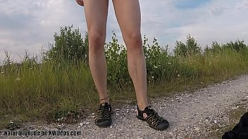 Hiking naked on dirt road warm sun...