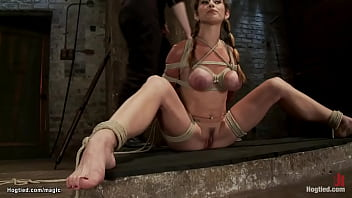 Busty hogtied in inverted suspension