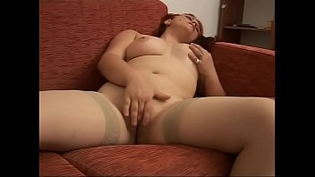 Young and chubby redhead fingering her wet pussy