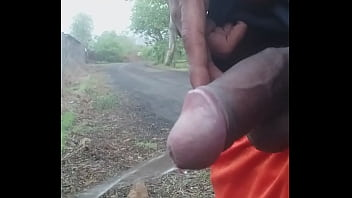 Indian cock pissing outdoor