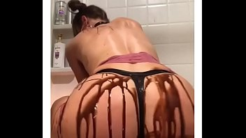 Chocolate sauce on perfect ass for her boyfriend...