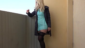 A blonde without panties smokes on a public balcony and masturbates with a dildo. Fetish and juicy PAWG under a short dress outdoor.