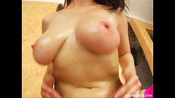 Takes off his shirt and show us her mega huge natural boobs