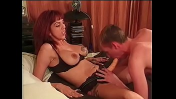 Nasty redhead babe wears a and fucks two...