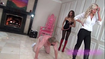 Harsh whipping by two cruel mistresses