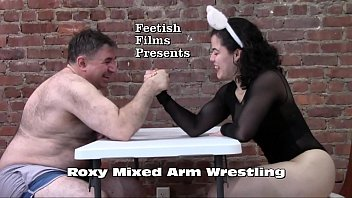 Strong girl roxy arm wrestles male...