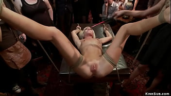 Blonde slave surrounded in public