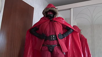 bella in red rubberlined suit