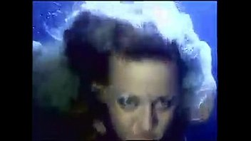 Sandy Knight and Robyn Foster in a threesome underwater
