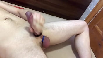 Young guy cums with cock and ball rings