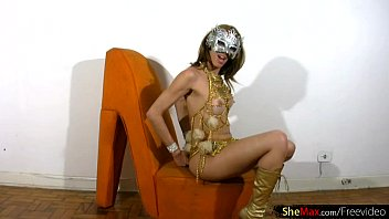 Pretty face tranny dressed up for carnival strokes big cock