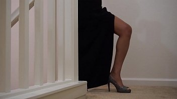 In long black dress with slit...