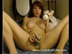 Skinny teen with huge natural tits fucks herself on cam at CumAndCam.com
